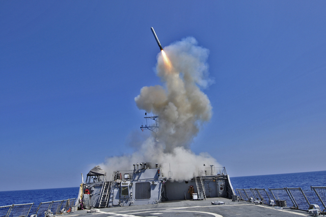 March 29, 2011 - The guided missile destroyer USS Barry (DDG-52) launches a Tomahawk cruise missile from the Mediterranean Sea in support of Operation Odyssey Dawn.